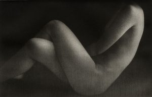 nude female with crossed legs