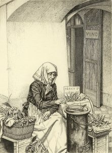 Old woman making sausage on street in Prague.
