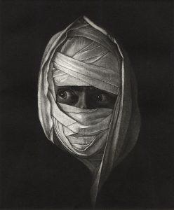 Face wrapped , peering eyes