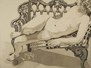 reclining female nude on ornate chair