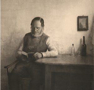 danish man with beard reading a book by Peter Ilsted