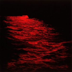 dark details of ocean with red tint