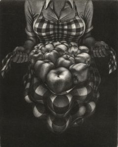woman in checked shirt holding a bundle of apples