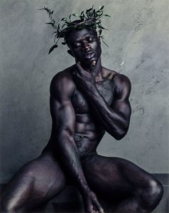 naked man with crown made of a vine