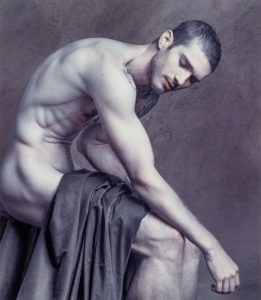 naked man with cloth draped over lap