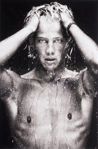 young nude Dutch boy is dripping wet and looking directly out